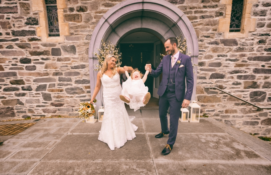 Bride and groom with daughter in Kerry