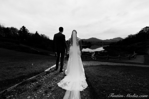 Bride and Groom pose for a portrait at Sneem hotel in Sneem Co Kerry