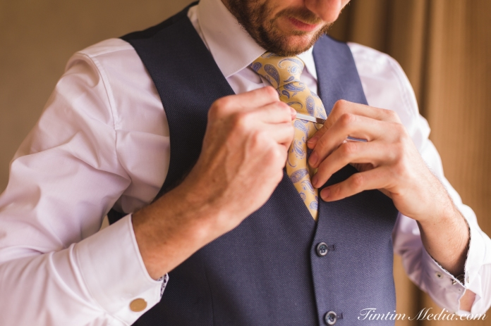 Groom fixes his tie in Sneem hotel Sneem Co Kerry