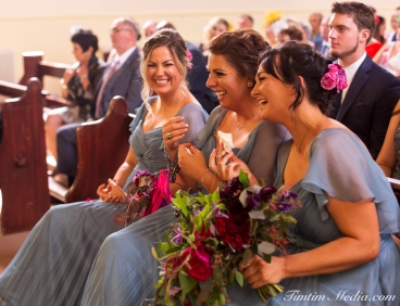 Bridesmaids laugh during the wedding ceremoney in Co Cork